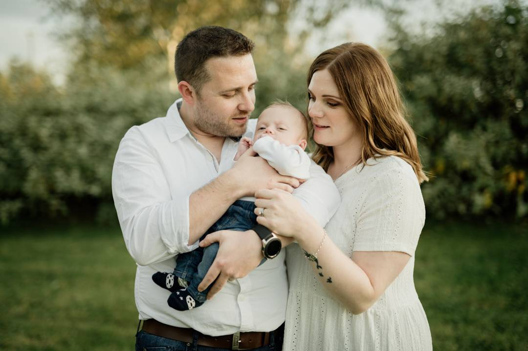 The Byrne family in the park during baby photography session
