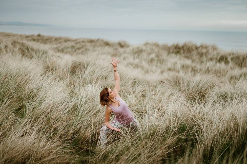 Yoga teacher in dunes on branding photo session in Wexford