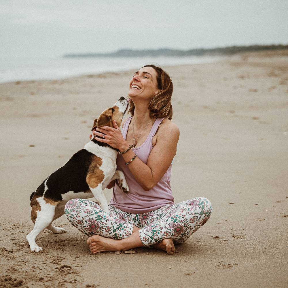 Yoga teacher with the dog on branding photo session in Wexford