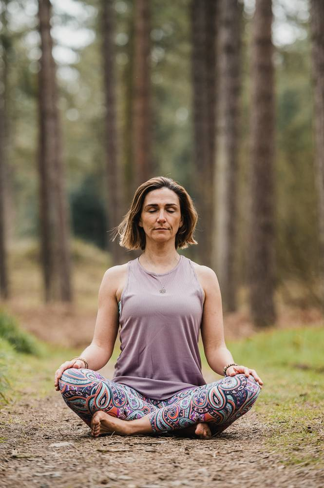 Yoga teacher in lotus pose on branding photo session in Raven wood, wexford