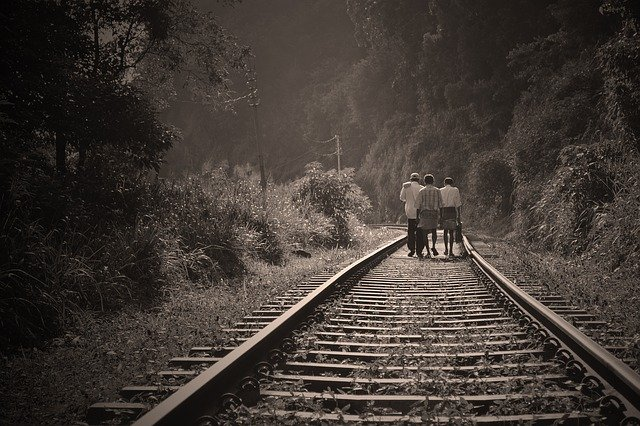 leading lines of rail track help to focus on children photography subject